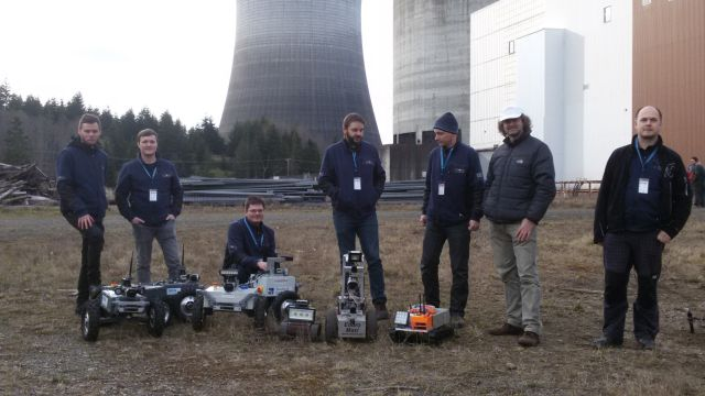 Robotika team with robots at the nuclear power plant